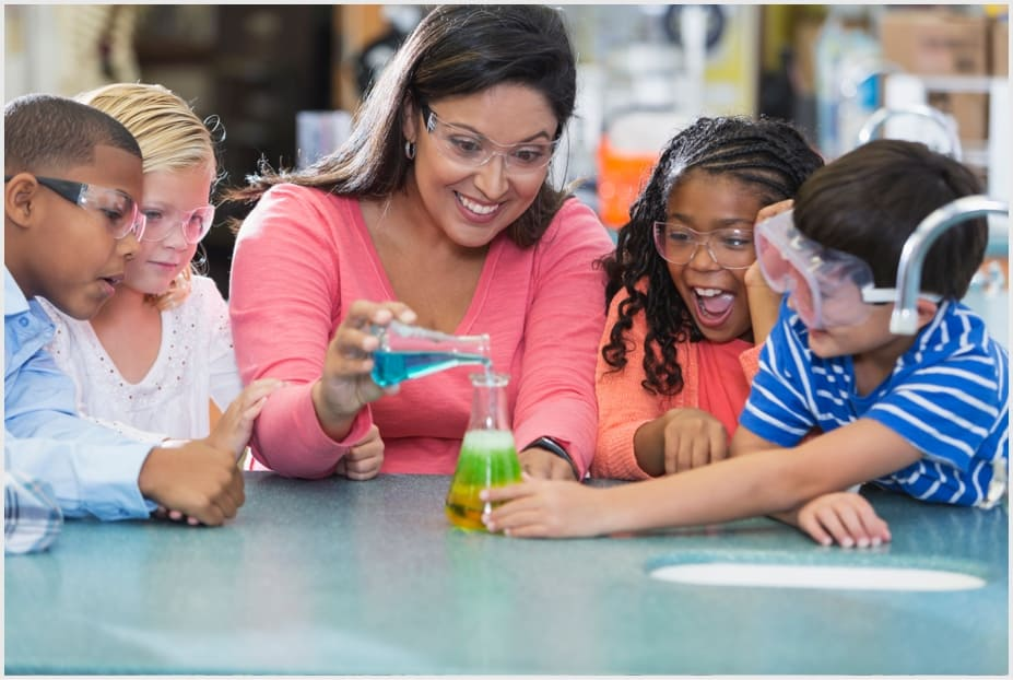 Teacher doing science experiment with students